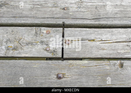 Wooden plank with Rusty Old Nails hammered into them - Stock Photo