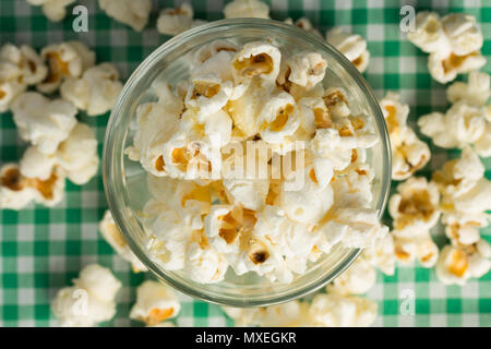 Popcorn. Food of Festa Junina, a typical brazilian party, holiday event in June. Snack on green plaid table. - Stock Photo