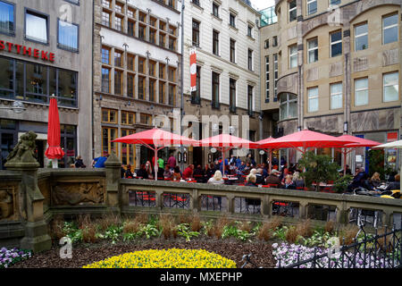 Near Cologne Cathedral in the center of the city are many hidden places.  You can sit outside there and drink your 'Kölsch', a local beer. - Stock Photo