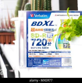 GOMEL, BELARUS - MAY 30, 2018: Mitsubishi (Verbatim) BD-R XL 100GB disc on a variocolor background. - Stock Photo