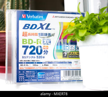 GOMEL, BELARUS - MAY 30, 2018: Mitsubishi (Verbatim) BD-R XL 100GB disc on a variocolor background. - Stock Photo