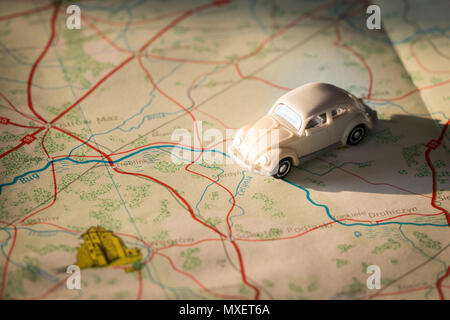 Miniature car on the Polish map, concept of holiday trip - Stock Photo