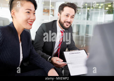 Productive Negotiations with Business Partner - Stock Photo