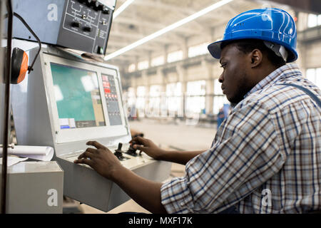 Machine Operator Focused on Work - Stock Photo