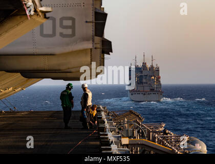 180603-N-ZK016-0001    U.S. 5TH FLEET AREA OF OPERATIONS (June 3, 2018) Boatswain's Mate 3rd Class Jeffrey Boekeloo prepares the phone and distance line on the flight deck of the Wasp-class amphibious assault ship USS Iwo Jima (LHD 7) before an underway replenishment, June 3, 2018. Iwo Jima, homeported in Mayport, Fla., is on deployment to the U.S. 5th Fleet area of operations in support of maritime security operations to reassure allies and partners, and preserve the freedom of navigation and the free flow of commerce in the region. (U.S. Navy photo by Mass Communication Specialist 3rd Class  - Stock Photo