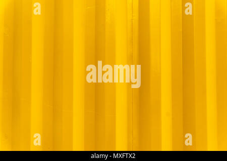 Berlin, Germany, May 26, 2018: Vertical Pattern of Yellow Corrugated Metal Wall - Stock Photo