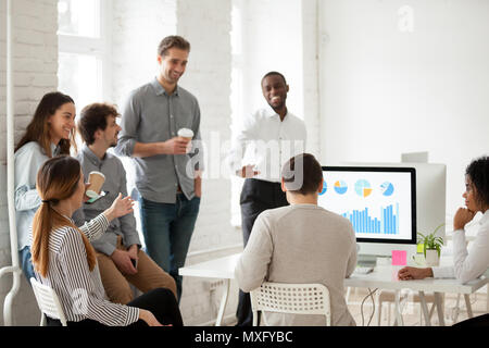 Multiracial team having fun during work break - Stock Photo