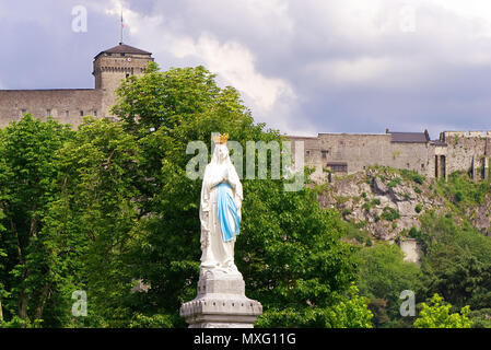 Statue of Our Lady of Immaculate Conception. Lourdes, France, major place of catholic pilgrimage. - Stock Photo