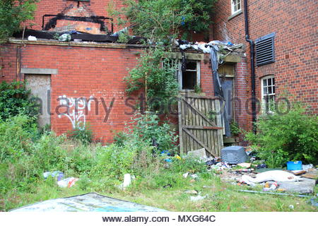Rubbish & Fly-Tipping At The Rear Of The Derelict Blues Night Club & Fun Bar On Stamford Street Ashton-Under-Lyne Tameside England June 2018 - Stock Photo