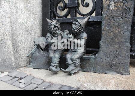 Dwarfs in Wroclaw, Poland. Bronze statues around the city. - Stock Photo