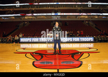 The 2015 U.S. Army Soldier of the Year Sgt. Jared Tansley, Illinois native, pauses for a photo before the Chicago Bulls vs. New York Knicks game at the United Center, Nov. 4, 2016. Tansley attended the game as part of a hometown recognition here in Illinois. During his visit, Tansley spoke at numerous locations throughout Chicago and Illinois to include his former high school in Sycamore, Illinois.   (U.S. Army photo by Anthony L. Taylor/Released) - Stock Photo
