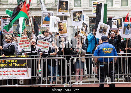 Pro-Palestinian protesters seen protesting against the Celebrate Israel Parade on Fifth Avenue in New York City. A parade hosted in New York City to celebrate the 70th anniversary of founding of the Israeli nation. - Stock Photo