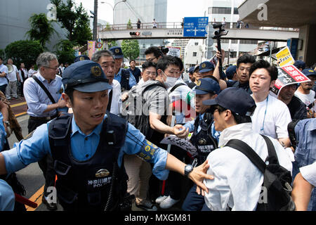 KAWASAKI, JAPAN - JUNE 03: Protesters holding up signs, including one saying 'NO HATE & NO RACISM' gather in front of Educational Cultural Hall in Kawasaki, Kanagawa prefecture, Japan on June 3, 2018. The anti-racist group forcefully stop the nationalists attendees from entering the building for a planned meeting by a hate speech members in Kanto region following a scuffle with the police, nationalists and the protesters. (Photo: Richard Atrero de Guzman/Aflo) - Stock Photo