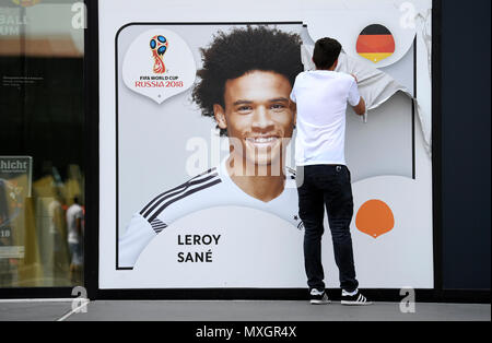 04 June 2018, Germany, Dortmund: Soccer, world cup, German national team. A staff member removing the portrait of Leroy Sane from the outside wall of the football museum. Head coach Loew announced the final 23 man squad for the world cup today. Photo: Ina Fassbender/dpa - Stock Photo
