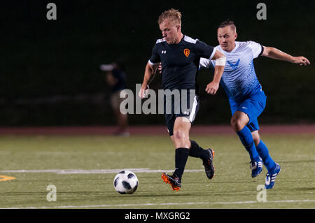 June 3, 2018 - Fort Bragg, North Carolina, US - June 3, 2018 - Fort Bragg, N.C., USA - All-Army Soccer 1st Lt. Alexander Clark (10) and All-Air Force Soccer Capt. John Melcher (8) in action during a first round match between the U.S. Army and U.S. Air Force at the 2018 Armed Forces MenÃ•s Soccer Championship, at Hedrick Stadium, on Fort Bragg. Air Force, the defending Armed Forces champions, defeated Army 2-1 in overtime. The Armed Forces MenÃ•s Soccer Championship is conducted every two years. (Credit Image: © Timothy L. Hale via ZUMA Wire) - Stock Photo