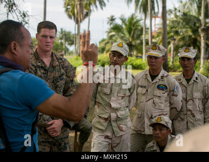 A Cambodian man interprets for U.S. Marine 1st Lt. Ben Matson to Royal Cambodian Navy Sailors at Ream Naval Base, Sihanoukville, Cambodia, Nov. 2, 2016. U.S. Marines instructed the Cambodian Sailors on Combat Rubber Reconnaissance Craft (CRRC) operation and amphibious raids during Cooperation Afloat Readiness and Training (CARAT) 16. CARAT 2016 is a nine-country, bilateral exercise series between the United States and Bangladesh, Brunei, Cambodia, Indonesia, Malaysia, Singapore, the Philippines, Thailand, and Timor-Leste. This phase of CARAT focuses on partnerships between the forces of the US - Stock Photo