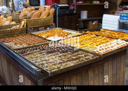 9 May 2018 A large and colourful selection of sweet bread and pastries  prepared and on sale at a stall at the Mahane Yehuda covered market in Jerusal - Stock Photo