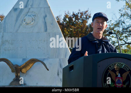 Coast Guard Commandant Adm. Paul Zukunft speaks at the 'Flags Across America' event at Arlington National Cemetery, Arlington, Va., Nov. 5, 2016. 'As you walk through the national cemetery, it reminds us that freedom is not free,' he told the crowd of volunteers, including Coast Guard members and their families, who came out to place American and Coast Guard flags on the graves of Coast Guardsmen. Flags Across America is organized by the Washington D.C. Coast Guard Chief Petty Officers Association and held each year on the weekend before Veterans Day. Coast Guard photo by Petty Officer 2nd Cla - Stock Photo