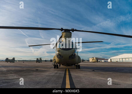 A CH-47 Chinook sits on Hunter Army Airfield prior to a sling load operation, Nov. 6, 2016. (U.S. Army photo by Lt. Col. Brian J. Fickel) - Stock Photo