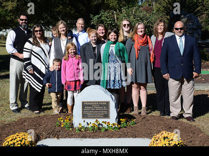 Family members of William J. Franssen, Sr. gather around his memorial after an unveiling ceremony at Joint Base Langley-Eustis, Va., Nov. 8, 2016. During his 40 years of service to Morale, Welfare and Recreation programs, Franssen worked to improve the quality of life for U.S. Army Soldiers and their families.(U.S. Air Force photo by Staff Sgt. Teresa J. Cleveland) - Stock Photo