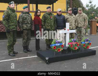 YAVORIV, Ukraine - Leaders with the Joint Multinational Training Group-Ukraine following a Remembrance Day ceremony here, November 11, 2016. Remembrance Day is a memorial day observed by the Commonwealth of Nations member states since the end of the First World War to remember the members of their armed forces who have died in the line of duty. JMTG-U focuses on building a sustainable and enduring training capacity and capability within the Ukrainian land forces.  (U.S.Army photo by Spc. John Onuoha / Released) - Stock Photo