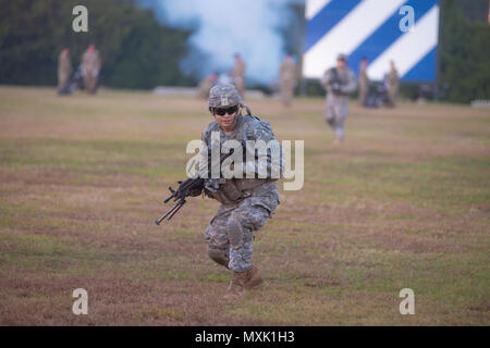 A 3rd Infantry Division infantry squad participates in Twilight Tattoo at Fort Stewart Nov. 15, 2016. (Photo by LTC Brian J. Fickel) - Stock Photo