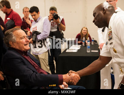 161112-N-SO730-293  COLLEGE STATION, Texas (Nov. 16, 2016) USS George H.W. Bush (CVN 77) Command Master Chief Huben Phillips meets former president George H.W. Bush during a military appreciation football game at Texas A&M University. The game is part of a two-day namesake trip to Texas where Sailors engaged with the local community about the importance of the Navy in defense and prosperity. (U.S. Navy photo by Seaman Joe Boggio / Released)