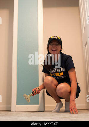 161111-N-SO730-079 (COLLEGE STATION, Texas) Petty Officer 1st Class Joanna Waugh, 2016 Senior Sailor of the Year for the aircraft carrier USS George H.W. Bush (CVN 77), scrapes the foundation of a home during a Habitat for Humanity project in College Station, Texas. The project is part of a two-day namesake trip to Texas where Sailors engaged with the local community about the importance of the Navy. (U.S. Navy photo by Seaman Joe Boggio/Released)