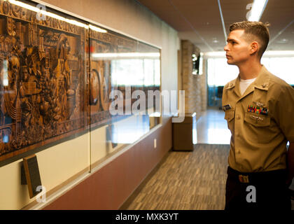 161112-N-SO730-021  COLLEGE STATION, Texas (Nov. 16, 2016) Petty Officer 2nd Class Andrew Tonski, 2016 Junior Sailor of the Year for the aircraft carrier USS George H.W. Bush (CVN 77), views the history of Texas A&M University during a tour of the campus at College Station, Texas. The tour is part of a two-day namesake trip to Texas where Sailors engaged with the local community about the importance of the Navy. (U.S. Navy photo by Seaman Joe Boggio/Released)
