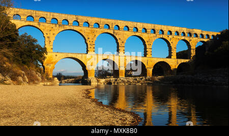 Picture of old Roman Bridge Pont du Gard in autumn in South of France - Stock Photo