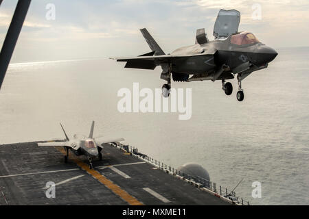PACIFIC OCEAN-- An F-35B Lightning II hovers before landing aboard the USS America (LHA 6) during the Lightning Carrier Proof of Concept Demonstration, November 19, 2016. The demonstration is the first shipboard Marine Corps F-35B integration demonstration alongside other Marine Corps Air Combat Element assets. (U.S. Marine Corps Photo by Cpl. Thor Larson/Released)
