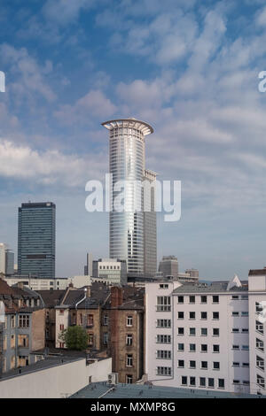 A mix of modern and traditional architecture, with Westendstrasse 1 tower block and residential housing in the foreground, Frankfurt am Main, Germany. - Stock Photo