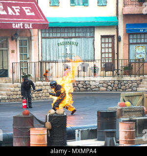 Lights, Motors, Action! Stunt Show Spectacular, discontinued stunt show with man aflame, burning, with extinguisher in frame. Disney Studios, Orlando - Stock Photo