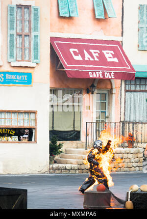 Lights, Motors, Action! Stunt Show Spectacular, discontinued stunt show with man aflame, burning, only stunt man in frame. Disney Studios, Orlando, FL - Stock Photo