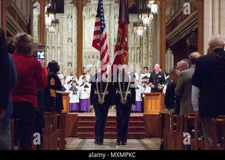 U.S. Marine Corps Color Guard, Marine Barracks Washington, retires the colors during the Marine Corps Worship Service at the Washington National Cathedral, Washington, D.C., Nov. 13, 2016. The worship service honored the 241st anniversary of the Marine Corps. (U.S. Marine Corps photo by Lance Cpl. Daisha R. Sosa) - Stock Photo