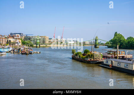 A view looking down The River Thames towards The Hammersmith Bridge in London. - Stock Photo