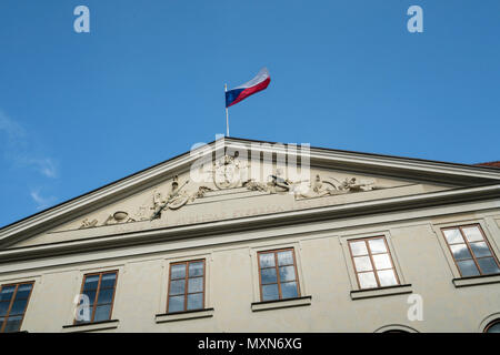 The Czech flag waving over a palace in Prague, Czech Republic - Stock Photo