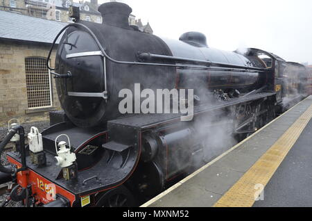 A steam train leaving Whitby Station on the North York Moors Railway. The model is a B1 Class designed by Edward Thompson running between 1947 to 1965 - Stock Photo