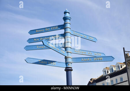 A sign on West Cliff in Whitby, North Yorkshire showing the distances involved to places connected with Captain Cook - Stock Photo