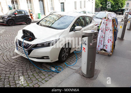 Electric car charging, Nissan leaf, Montmartre, Paris, France, - Stock Photo