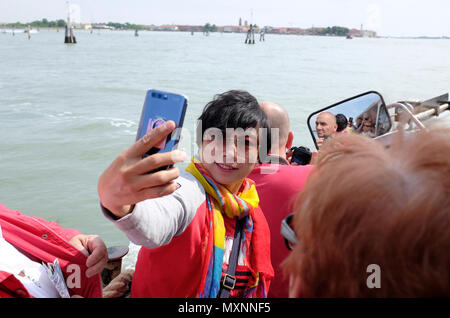female asian tourist taking selfie on boat in venice, italy - Stock Photo