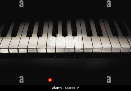 Black and white piano keys in dark ambiance. Part of modern midi controller. - Stock Photo