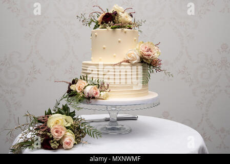 Champagne wedding cake with yellow and pink flower arrangements champagne wedding cake with yellow and pink flower arrangements stock photo mightylinksfo