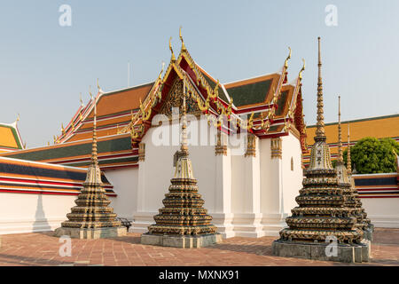 Ornate decorations  on the tops of the pagodas or chedis in the Wat Pho ,the Temple of the Reclining Buddha, or Wat Phra Chetuphon, Bangkok, Thailand - Stock Photo