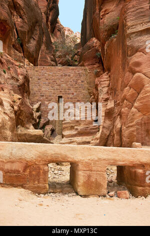 ancient watersupply and dam against flood in canyon, ancient pavestones, Siq of Petra, canyon of Petra Archaeological Park, Petra, Jordan, Asia Minor  - Stock Photo