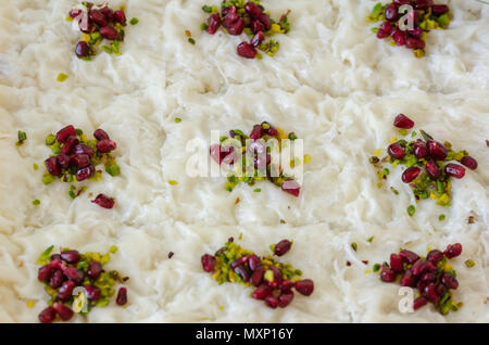 Traditional Ramadan Dessert Gullac.It is made with gullac, milk, rose water, walnut, vanilla. It is decorated with pomegranate  and pistachio. - Stock Photo