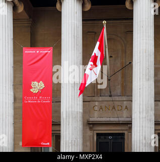 Canada House entrance, City of Westminster, London SW1, the Canadian High Commission, with red and white Canadian national flag and banner - Stock Photo