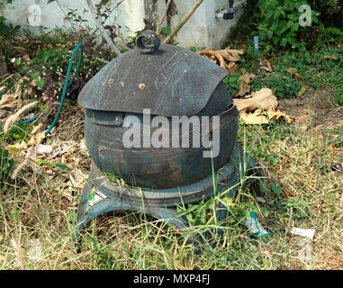 Public dustbin with cover, both manufactured from rubber and mounted on cast iron stand in a street in Udon Thani, Thailand - Stock Photo