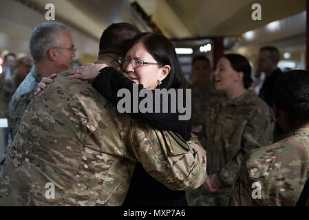 Mrs. Ricki Selva, wife of U.S. Air Force Gen. Paul J. Selva, vice chairman of the Joint Chiefs of Staff, hugs a U.S. service member at Kandahar Airfield, Afghanistan, Nov. 24, 2016. Gen. Selva and Mrs. Selva visited troops across Afghanistan to spend Thanksgiving Day with them and thank them for their service. (DoD Photo by U.S. Army Sgt. James K. McCann) - Stock Photo