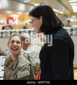 Mrs. Ricki Selva, wife of U.S. Air Force Gen. Paul J. Selva, vice chairman of the Joint Chiefs of Staff, meets with U.S. service members during lunch at Kandahar Airfield, Afghanistan, Nov. 24, 2016. Gen. Selva and Mrs. Selva visited troops across Afghanistan to spend Thanksgiving Day with them and thank them for their service. (DoD Photo by U.S. Army Sgt. James K. McCann) - Stock Photo